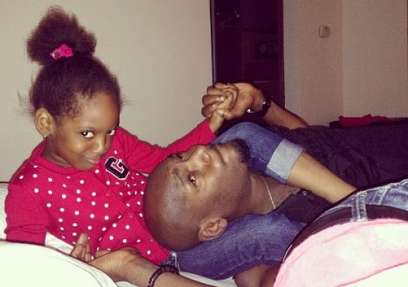 2face and his daughter, Isabella.